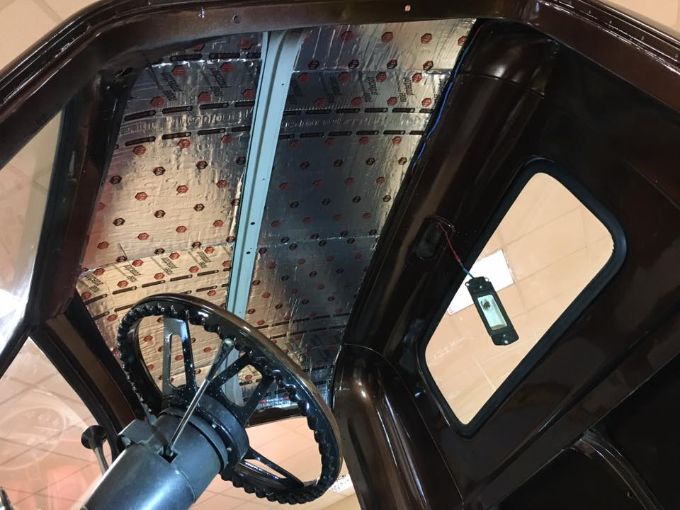 An Example of a Chevy Pickup applying 4mm VibroFiltr Sound deadening mats to the roof in our workshop in Kilkenny Ireland