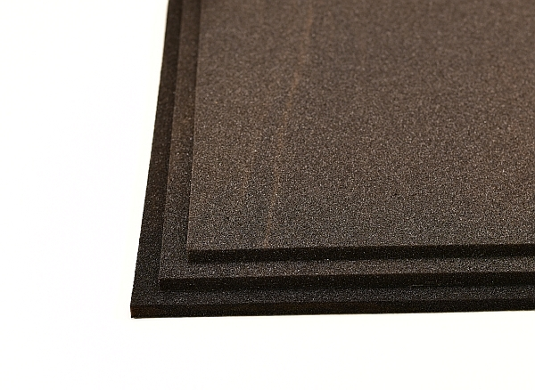black layer sound insulation sheets in a stack