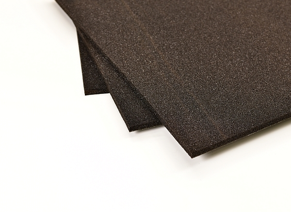 black layer sound insulation sheets in a fanned stack